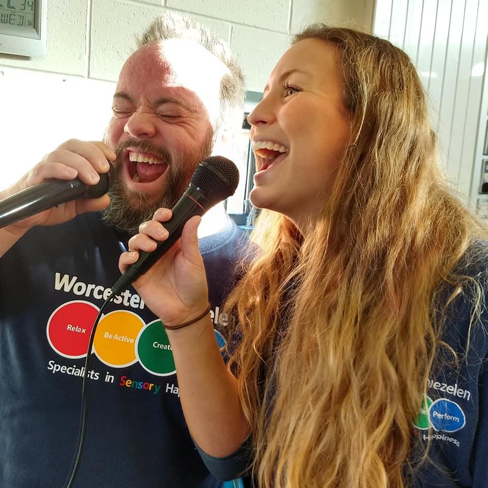 Man and woman singing karaoke