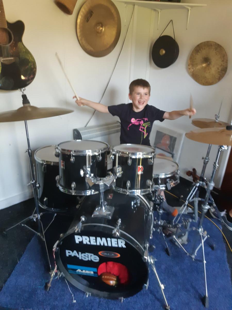 Leonard playing drums