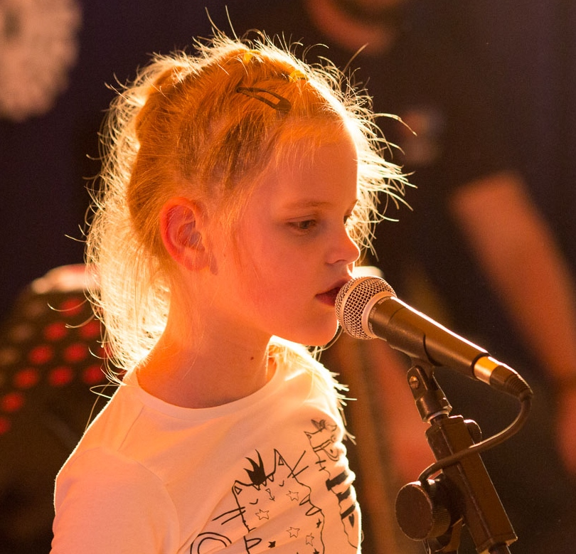 Girl speaking into microphone